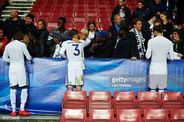 Danny Amankwaa Ludvig Augustinsson and Erik Johansson of FC Copenhagen celebrate with family and friends after the UEFA Champions League match...