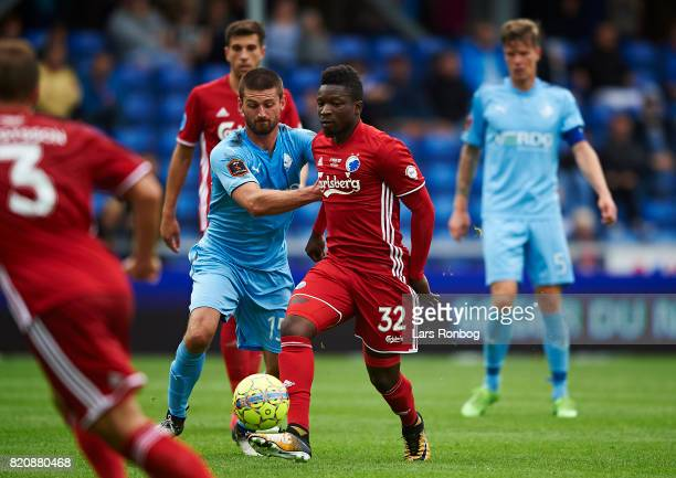 Danny Amankwaa of FC Copenhagen and $1r15$ compete for the ball during the Danish Alka Superliga match between Randers FC and FC Copenhagen at...