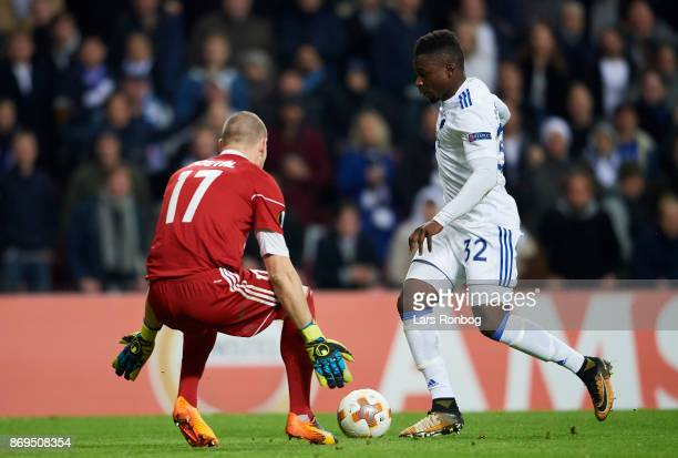 Danny Amankwaa of FC Copenhagen and Goalkeeper Stanislav Dostal of FC Zlin compete for the ball during the UEFA Europa League match between FC...
