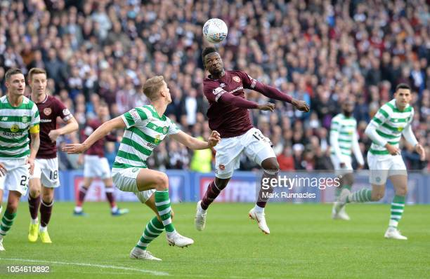 Danny Amankwaa of Heart of Midlothian FC controls the ball as Kristoffer Ajer of Celtic watches on during the Betfred Scottish League Cup Semi Final...