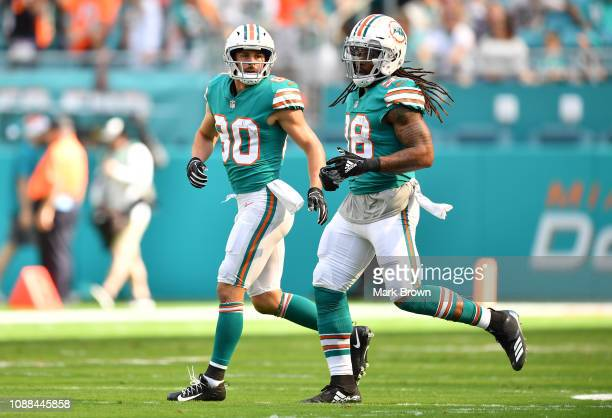 Danny Amendola and Brandon Bolden of the Miami Dolphins in action against the Jacksonville Jaguars at Hard Rock Stadium on December 23 2018 in Miami...