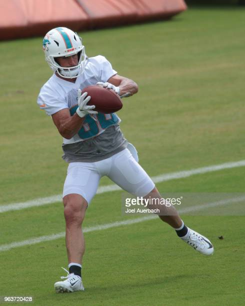 Danny Amendola of the Miami Dolphins catches the ball during the teams training camp on May 30 2018 at the Miami Dolphins training facility in Davie...