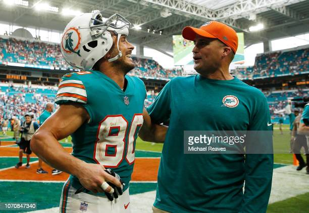 Danny Amendola of the Miami Dolphins celebrates their 34 to 33 win over the New England Patriots at Hard Rock Stadium on December 9 2018 in Miami...