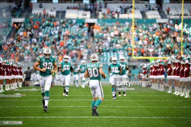 Danny Amendola of the Miami Dolphins gets introduced before the game against the Jacksonville Jaguars at Hard Rock Stadium on December 23 2018 in...