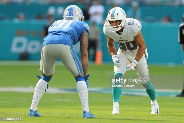 Danny Amendola of the Miami Dolphins in action Teez Tabor of the Detroit Lions at Hard Rock Stadium on October 21 2018 in Miami Florida
