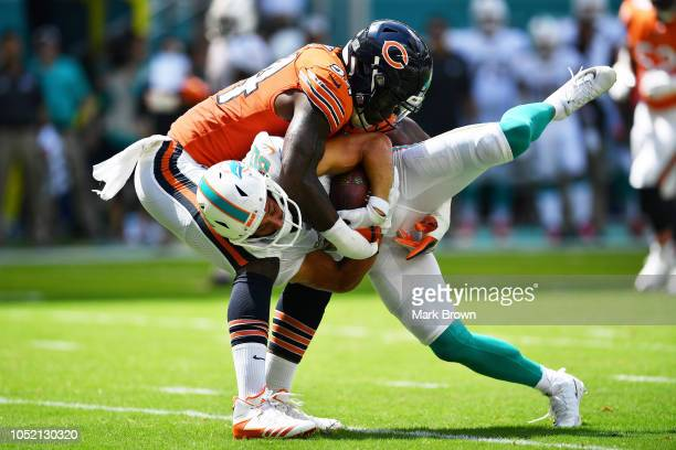 Danny Amendola of the Miami Dolphins is picked up by Leonard Floyd of the Chicago Bears in the first quarter of the game at Hard Rock Stadium on...