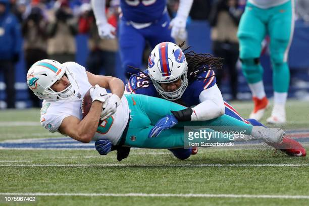 Danny Amendola of the Miami Dolphins is tackled after making a recption by Tremaine Edmunds of the Buffalo Bills in the third quarter during NFL game...
