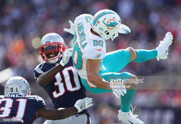 Danny Amendola of the Miami Dolphins is unable to catch a pass during the first half as he is defended by Jason McCourty of the New England Patriots...