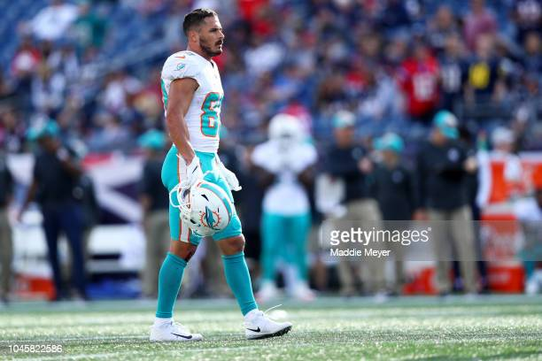 Danny Amendola of the Miami Dolphins looks on during the game against the New England Patriots at Gillette Stadium on September 30 2018 in Foxborough...