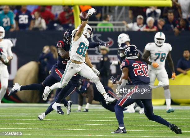 Danny Amendola of the Miami Dolphins reaches for a pass that was interecepted by Justin Reid of the Houston Texans in the first half at NRG Stadium...