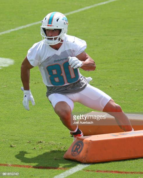 Danny Amendola of the Miami Dolphins runs a drill during the teams training camp on May 23 2018 at the Miami Dolphins training facility in Davie...