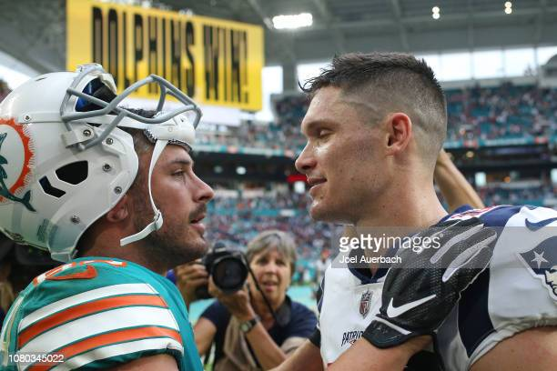 Danny Amendola of the Miami Dolphins talks to Chris Hogan of the New England Patriots after the NFL game on December 9 2018 at Hard Rock Stadium in...