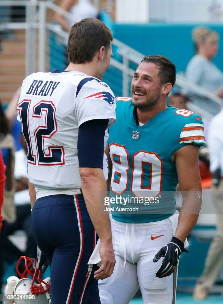 Danny Amendola of the Miami Dolphins talks to Tom Brady of the New England Patriots prior to an NFL game on December 9 2018 at Hard Rock Stadium in...