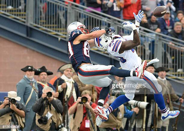 Danny Amendola of the New England Patriots attempts to make the catch in the third quarter against Aaron Williams of the Buffalo Bills at Gillette...