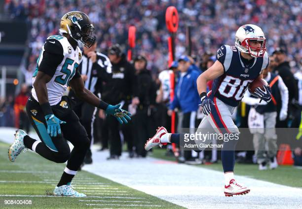 Danny Amendola of the New England Patriots carries the ball after a catch as he is defended by Telvin Smith of the Jacksonville Jaguars in the first...