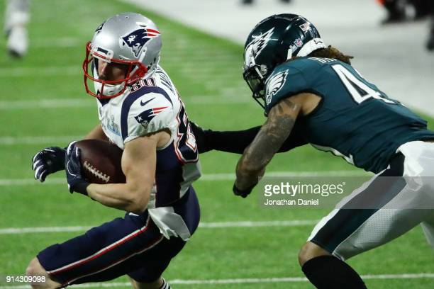Danny Amendola of the New England Patriots carries the ball against Ronald Darby of the Philadelphia Eagles i the first half of n Super Bowl LII at...