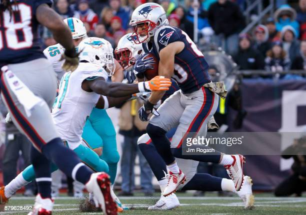 Danny Amendola of the New England Patriots carries the ball during the second quarter of a game against the Miami Dolphins at Gillette Stadium on...