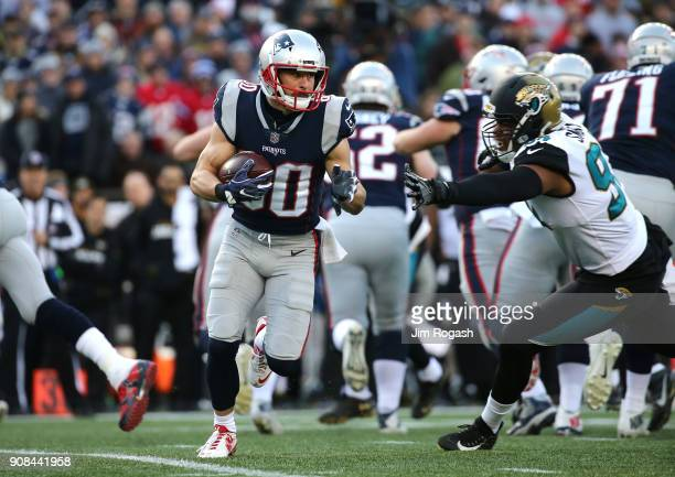 Danny Amendola of the New England Patriots carries the ball in the first half during the AFC Championship Game against the Jacksonville Jaguars at...