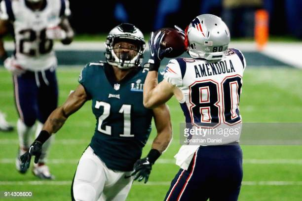 Danny Amendola of the New England Patriots catches a pass against Patrick Robinson of the Philadelphia Eagles in the first half of Super Bowl LII at...