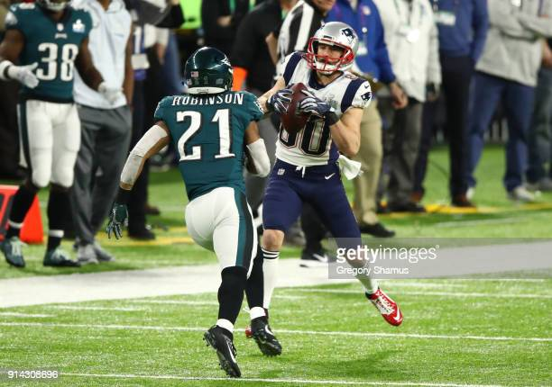 Danny Amendola of the New England Patriots catches a pass against Patrick Robinson of the Philadelphia Eagles during the first quarter in Super Bowl...