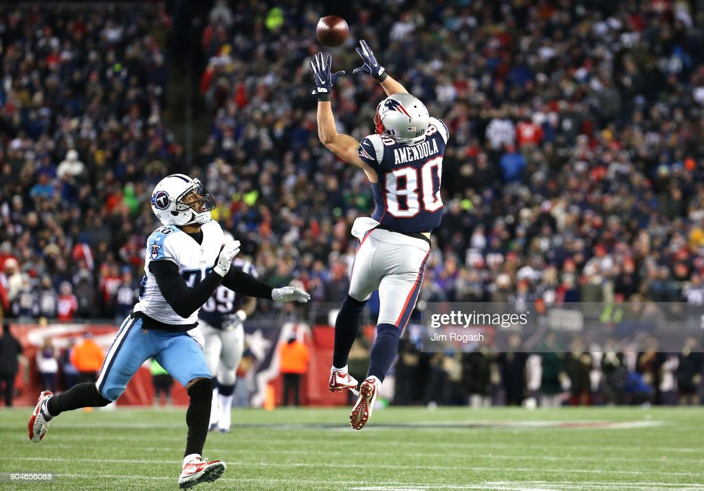 Danny Amendola #80 of the New England Patriots catches a pass as he is defended by Logan Ryan #26 of the Tennessee Titans during the fourth quarter in the AFC Divisional Playoff game at Gillette Stadium on January 13, 2018 in Foxborough, Massachusetts.