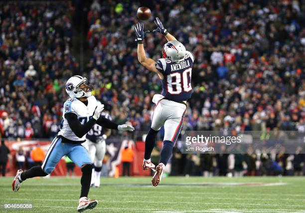 Danny Amendola of the New England Patriots catches a pass as he is defended by Logan Ryan of the Tennessee Titans during the fourth quarter in the...
