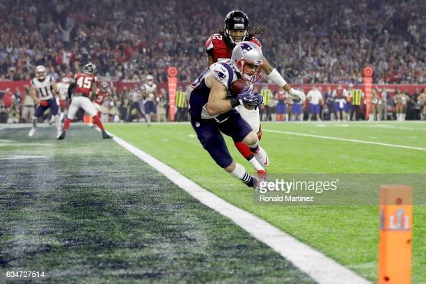 Danny Amendola of the New England Patriots catches a six yard touchdown in the fourth quarter against Jalen Collins of the Atlanta Falcons in the...