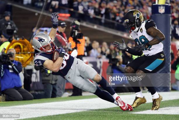 Danny Amendola of the New England Patriots catches a touchdown pass as he is defended by Tashaun Gipson of the Jacksonville Jaguars in the fourth...