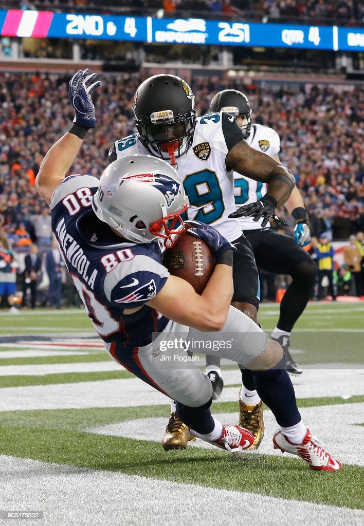 Danny Amendola #80 of the New England Patriots catches a touchdown pass as he is defended by Tashaun Gipson #39 of the Jacksonville Jaguars in the fourth quarter during the AFC Championship Game at Gillette Stadium on January 21, 2018 in Foxborough, Massachusetts.