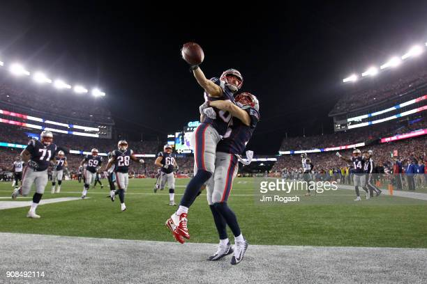 Danny Amendola of the New England Patriots celebrates a touchdown with Chris Hogan in the fourth quarter during the AFC Championship Game against the...
