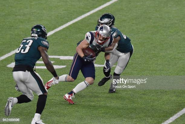 Danny Amendola of the New England Patriots gets tackled by Patrick Robinson of the Philadelphia Eagles during Super Bowl LII at US Bank Stadium on...