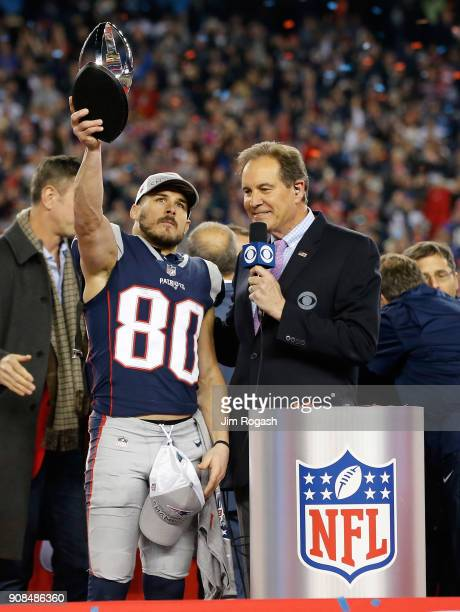 Danny Amendola of the New England Patriots holds the Lamar Hunt trophy as he is interviewed by Jim Nantz after the AFC Championship Game against the...