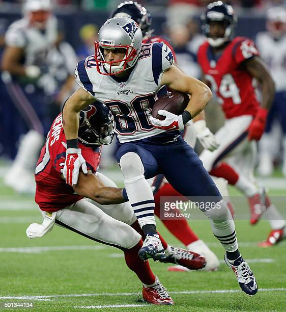 Danny Amendola of the New England Patriots hurdles overQuintin Demps of the Houston Texans at NRG Stadium on December 13, 2015 in Houston, Texas.