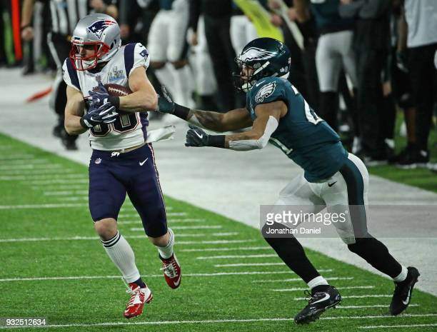 Danny Amendola of the New England Patriots is grabbed by Patrick Robinson of the Philadelphia Eagles during Super Bowl Lll at US Bank Stadium on...