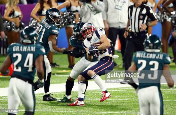Danny Amendola of the New England Patriots is tackled by the Philadelphia Eagles during the first quarter in Super Bowl LII at US Bank Stadium on...