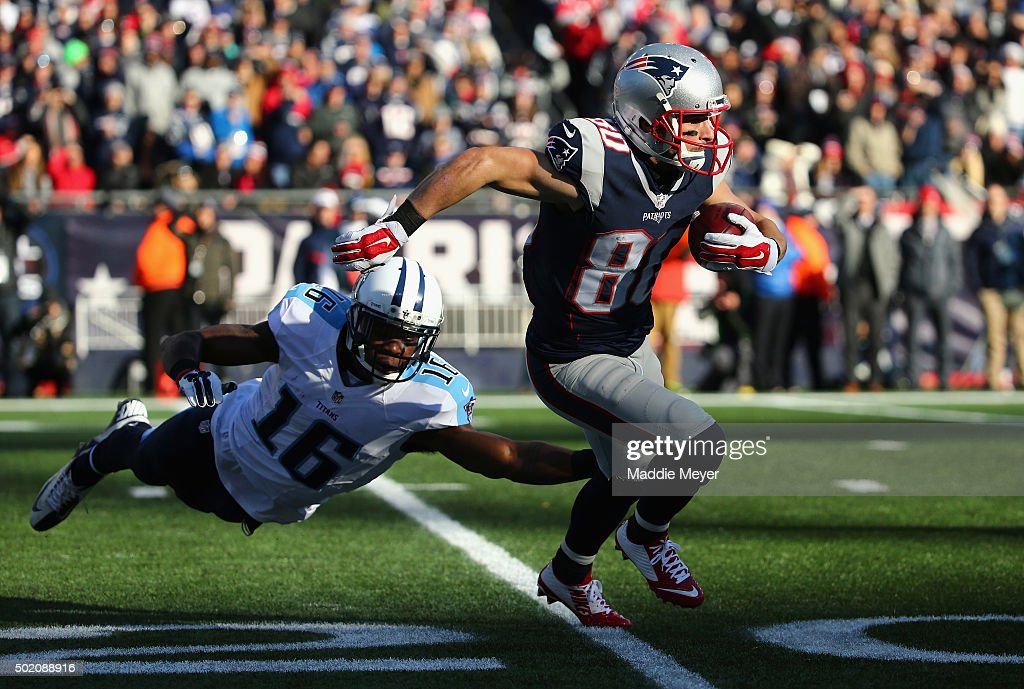 Danny Amendola #80 of the New England Patriots returns a punt as Tre McBride #16 of the Tennessee Titans attempts to tackle him during the first half at Gillette Stadium on December 20, 2015 in Foxboro, Massachusetts.