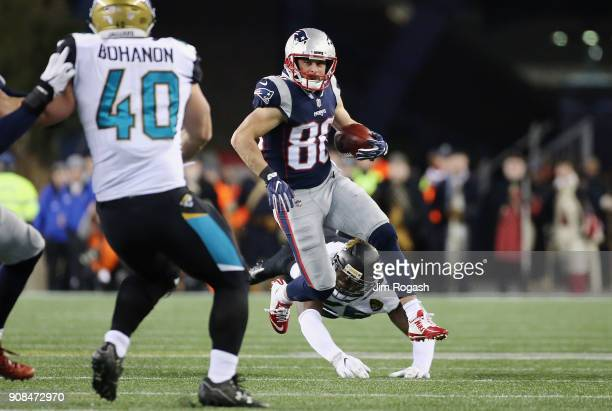 Danny Amendola of the New England Patriots returns a punt in the fourth quarter against the Jacksonville Jaguars during the AFC Championship Game at...