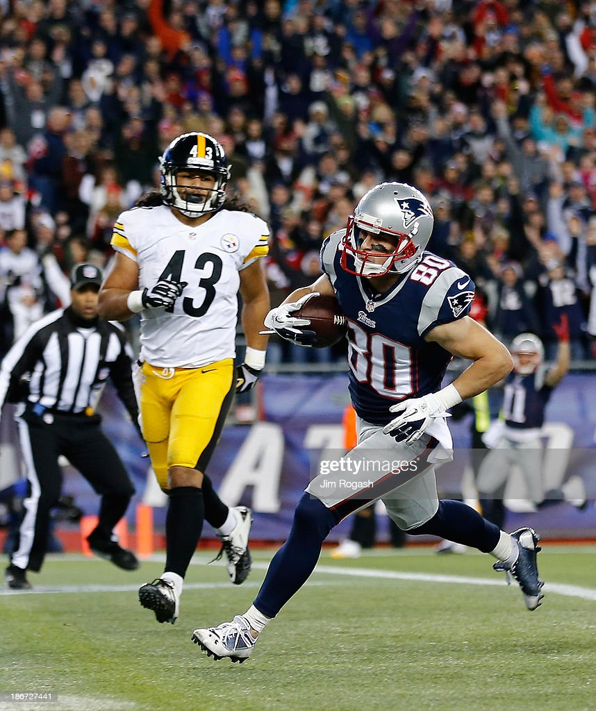 Danny Amendola #80 of the New England Patriots scores a touchdown by Troy Polamalu #43 of the Pittsburgh Steelers in the first quarter during a game at Gillette Stadium on November 3, 2013 in Foxboro, Massachusetts.