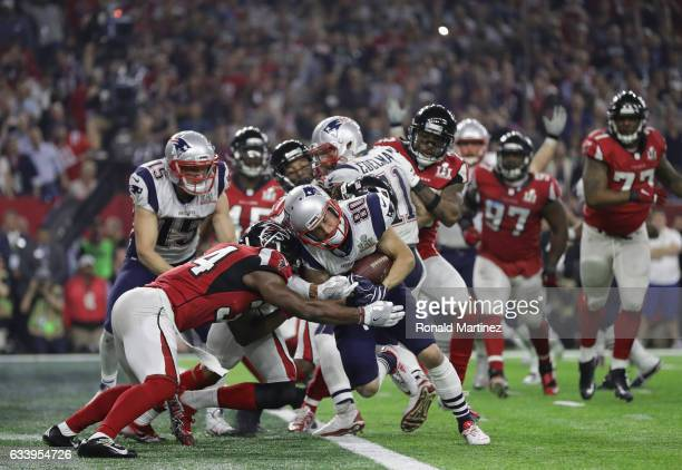 Danny Amendola of the New England Patriots scores a two point conversion late in the fourth quarter against Jalen Collins and Brian Poole of the...