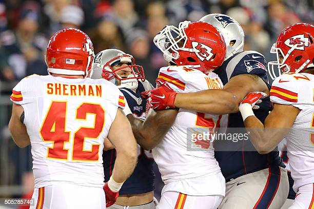 Danny Amendola of the New England Patriots shoves Dezman Moses of the Kansas City Chiefs after a play in the second quarter during the AFC Divisional...