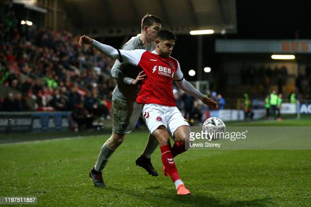 Danny Andrew of Fleetwood Town battles for possession with Steve Seddon of Portsmouth FC during the FA Cup Third Round match between Fleetwood Town...