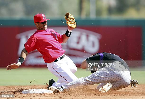 Danny Ardoin of the Colorado Rockies steals second base in the 2nd inning against Orlando Cabrera of the Los Angeles Angels of Anaheim on March 4...