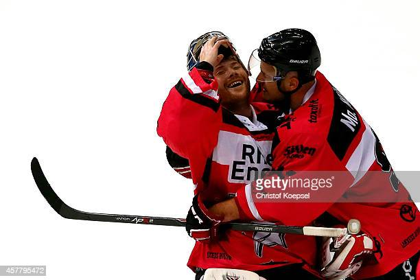 Danny aus den Birken and Moritz Mueller of Koelner Haie celebrate the 21 victory after the DEL Ice Hockey match between Koelner Haie and EHC Red Bull...