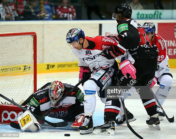 Danny aus den Birken . Goaltender of Koelner Haie and saves the shot of Darin Oliver of Eisbaeren Berlin battle for the puck during the DEL Ice...