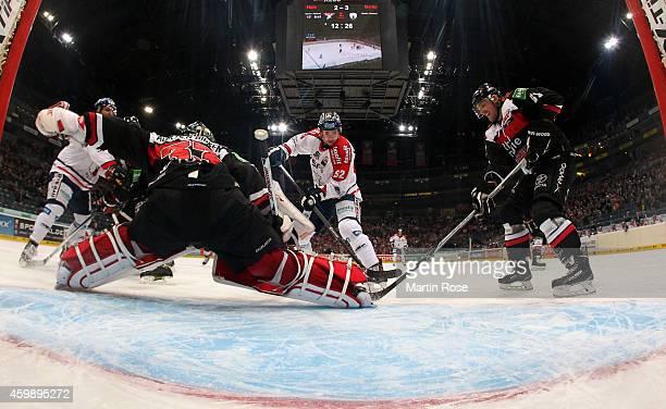 Danny aus den Birken , goaltender of Koelner Haie makes a save on Marcel Noebels of Eisbaeren Berlin during the DEL Ice Hockey match between Koelner...