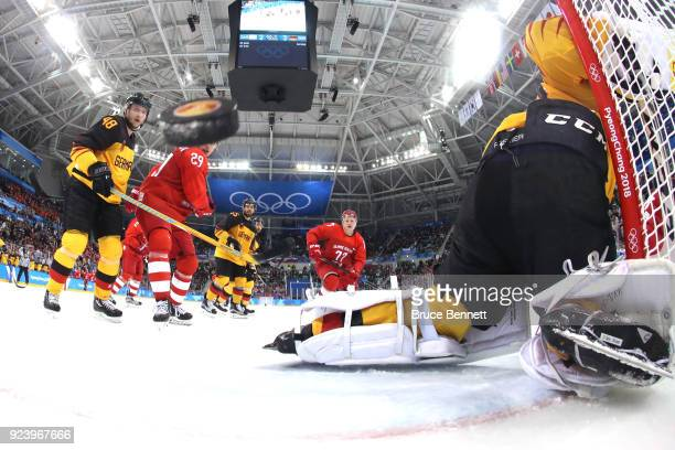 Danny Aus Den Birken of Germany allows a goal by Nikita Gusev of Olympic Athlete from Russia in the third period during the Men's Gold Medal Game on...