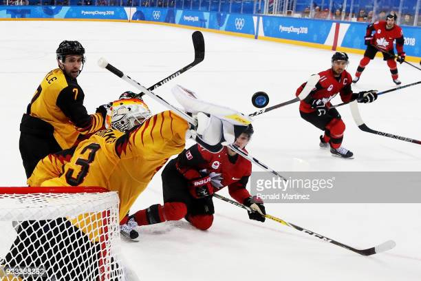 Danny Aus Den Birken of Germany blocks a shot during the game against Canada during the Men's Playoffs Semifinals on day fourteen of the PyeongChang...