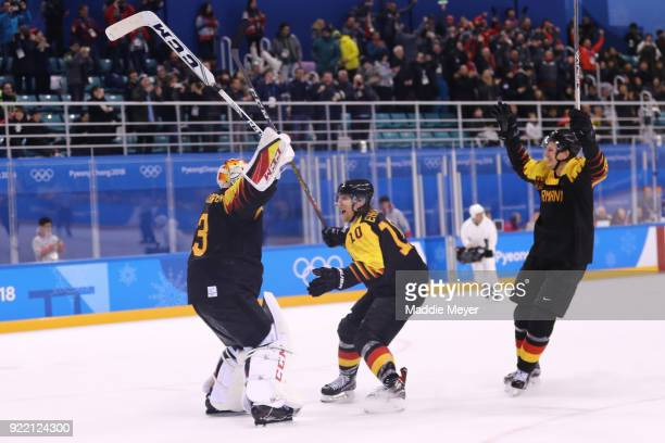Danny Aus Den Birken of Germany celebrates with his team after defeating Sweden 43 during the Men's Playoffs Quarterfinals game on day twelve of the...