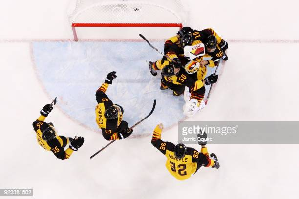 Danny Aus Den Birken of Germany celebrates with teammates after they defeated Canada 4 to 3 during the Men's Playoffs Semifinals on day fourteen of...