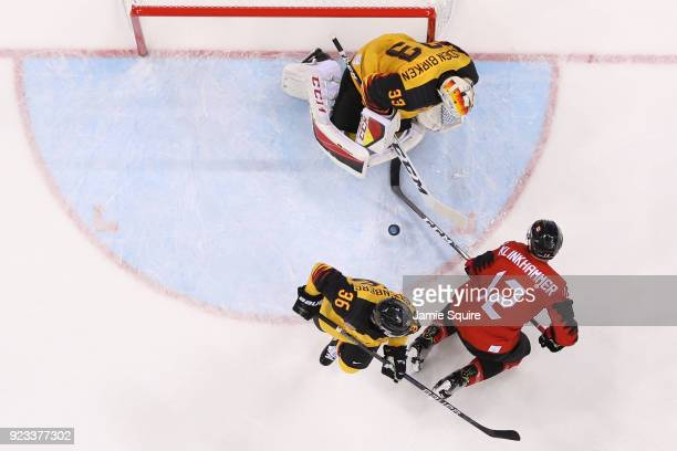 Danny Aus Den Birken of Germany defends against Rob Klinkhammer of Canada during the Men's Playoffs Semifinals on day fourteen of the PyeongChang...